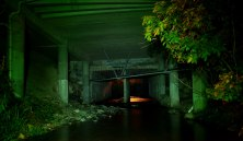 The stream passes right underneath many commercial properties.