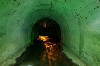The entrance to the tunnel looking out, here the walls have been light-painted green.